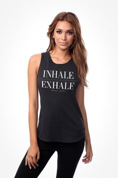 Just breathe in our super soft muscle tee... featuring bold front graphics, crew neck, and a flattering relaxed fit. The perfect edition to your yoga wardrobe!