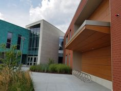 Beautiful mixture of facade materials with pre-patinated copper, stone and Fundermax HPL wood-grain