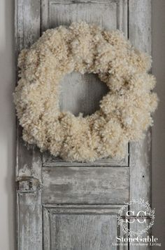 WOOL yarn pom-poms; needs a red bow- aaahhhh; StoneGable: ANTHROPOLOGIE INSPIRED TUFTED WOOL WREATH DIY