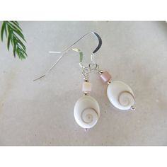 Shiva Shell earrings, Shell earrings, Sterling silver earrings, Pink... ($18) ❤ liked on Polyvore featuring jewelry, earrings, white shell earrings, sterling silver spiral earrings, long beaded earrings, shell earrings and beaded dangle earrings