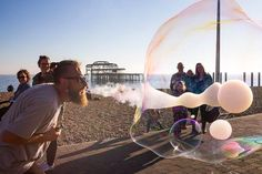Chris Harrison street photography - Brighton beach, bubble man Chris Harrison, Brighton, Storytelling, Street Photography, Burns, Bubbles, Concert, Beach, Instagram
