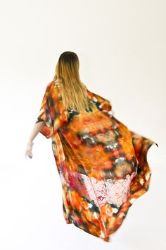 We love to dance in our bespoke, silk Kimono! Hand dyed with Devoré (burn out) detailing.  All our products are one of a kind due to the nature of our dyeing and printing techniques however we are able to recreate similar patterns and colours.  If you would like to order a similar design please email us at info@meiji-designs.co.uk or take a look at our Etsy shop.