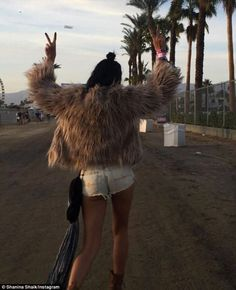 Peace out! Shanina Shaik has posted a throwback pic online from last year's Coachella festival