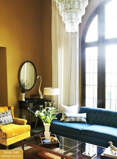 I saw this HGTV's blog by Jeanine Hays. I love the colors and the mid-century modern coffee table reminds me of the table I had in college.