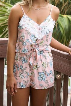 Feel flirty in this pale pink floral romper for a dinner date or a night out with friends! It features a drawstring waistband with tie in front