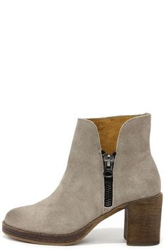 """The """"Becca"""" beats the heck out of last year's booties, with grey wax-rubbed suede contrasted by a tan sole and heel! Count on the MTNG Becca 90223 Waxed Antique Silver High Heel Ankle Boots to run the show with a rounded toe, and a 5"""" tall shaft that dips into a 4"""" gunmetal zipper (with antique finish) along the outstep. Available in European sizes, 36-41."""
