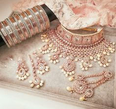 In all her Glory 😍Pretty Rose gold jewels for Priti 💕 To order your bridal jewels with us send us a dm or WhatsApp Shop ready… Bridal Jewellery Inspiration, Indian Bridal Jewelry Sets, Indian Jewelry Earrings, Bridal Bangles, Bridal Necklace Set, Jewelry Design Earrings, Pakistani Bridal Jewelry, Jewellry Box, Bling Jewelry