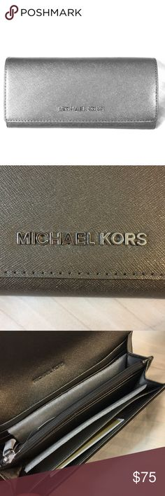 Brand New Michael Kors Clutch This gorgeous sparkly silver MK clutch is brand new and has never been used before! All of the original tags and packing are still inside and is in beautiful condition!   Let me know if you have any questions :) Michael Kors Bags Clutches & Wristlets