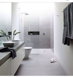 This is the sort of bathroom we would like, with very large stone like porcelain tiles