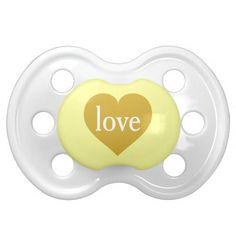 Love gold heart baby pacifiers.  Gender neutral baby shower gift.  #heartwarestore => http://www.zazzle.com/love_gold_heart_baby_pacifiers-256240653227156529?CMPN=addthis&lang=en&rf=238590879371532555&tc=pinhwsslovegoldheartpaci