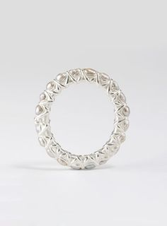 ooh pearls. I like pearls. I just worry I'd ruin them wearing them in a ring. Ruth Tomlinson Pearl Eternity Band.