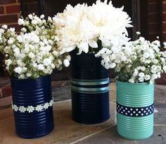 spray paint tin cans and add ribbon for cute, customized, and cheap vases-Love Teal  Navy Blue together