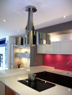 The shiny flowing lines of the Double Vertigo cooker hood from BEST - displayed at In-toto Kitchens in Wokingham.