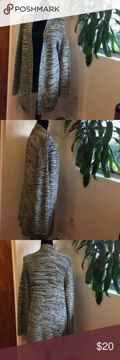 Express sweater Worn but in good shape with no issues pockets in the front and long enough to wear with leggings perfect for fall bundle for a better price! Express Sweaters