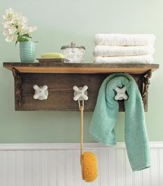 Salvaged barn siding was used to create this shelf for towels, and old faucet taps are doubling as hooks. #LiquidGoldSalvagedWood