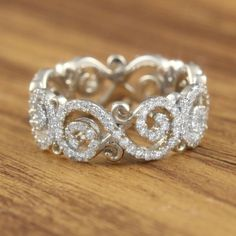 Sparkling Infinity Signs wrap your finger in diamonds! This Carved Infinity Pave Wedding Band is handcrafted in the metal and stones you want! Pave Wedding Bands, Wedding Rings Vintage, Pretty Rings, Beautiful Rings, Infinity Signs, Infinity Wedding, Diamond Engagement Rings, Solitaire Engagement, Fashion Rings