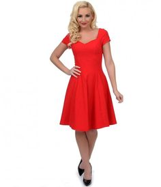 Roll out the red carpet darlings, Grace just exceeded our expectations! A captivating vibrant red cocktail dress that radiates vintage charm, boasting an enchanting sweetheart neckline, cuffed short sleeves and effortless A-line swing skirt. Princess seam