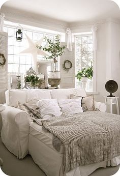 Love this bed/couch dream of a living room space!