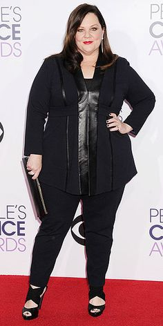 The Best Looks at the People's Choice Awards | MELISSA MCCARTHY | If the Mike and Molly star is giving us a sneak peek at her upcoming plus-size clothing line, consider us converts. The Favorite Comedic Movie Actress winner steps out in a sleek leather-paneled tunic top, slim black pants and a chunky pair of heels.