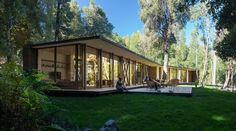 Casa en Lago Villarrica, completed by design studio Plan Maestro on a lake in Chile, features an X-shaped footprint to adapt to the surrounding forest.