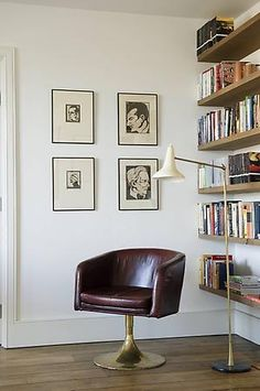 Floating shelves. Mid-century chair and lamp. Nice, clean, uncluttered but not at all sterile. Rose Uniacke - Interiors - London.