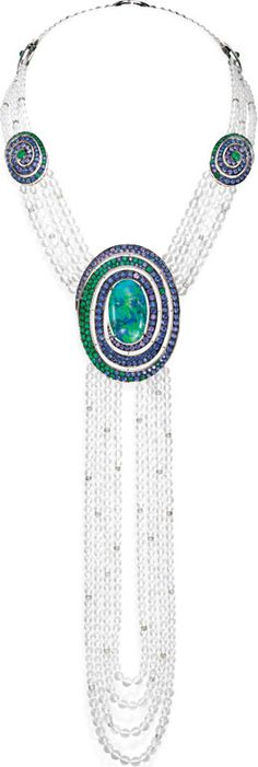 Baubles - Opulent Opals | Palm Beach Illustrated. The stunning Aiguebelle necklace by Boucheron features an opal cabochon with rock crystals, sapphires, diamonds and emeralds, all set in white gold. Price upon request. Neiman Marcus, Bal Harbour (305-865 6161, boucheron.com)