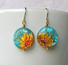 Normally not a fan of gold, but these Sunflower Earrings mother of pearl by JEWELRYANDMINIATURES on Etsy are gorgeous!