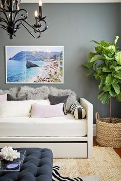 A gray living room wall lets everything else pop. House Tour: A Glamorous, Classic California Apartment Decoration Inspiration, Room Inspiration, Interior Inspiration, Home Design, Interior Design, Ficus Lyrata, California Apartment, Hanging Artwork, D House