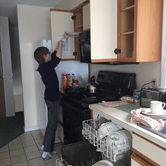 Making him do chores while on vacation. Love that the Nordic Village Resort townhomes making eating while traveling affordable. #JFFTravel #JFFHosted #FamilyTravel #NH