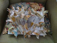 Wall hanging of folded book with butterflies made from old maps from a book of maps of Elizabethan making