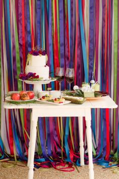 jewel tone streamers maybe draped over tables instead