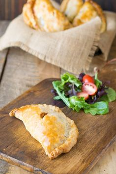 Traditional Cornish Pasty has potatoes and beef all wrapped in a tasty pastry. A perfect savory pie for filling lunch.