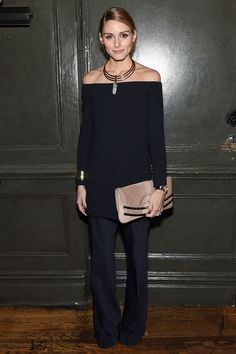 Olivia kept her outfit low key while at a screening for [i]Spectre[/i] in New York. She wore a navy long top and straight-leg trousers, but accessorised with a pretty necklace and matching clutch bag.