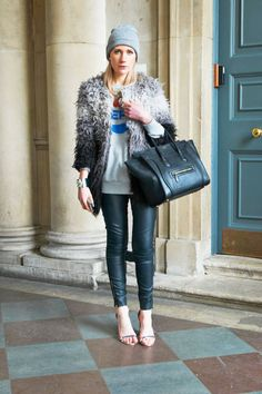 Leather skinnies, a vintage tee, and a fur coat make up serious rocker-chic building blocks #streetstyle