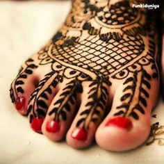 mendhi on feet with red nails