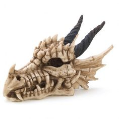 What safer place is there for your secret stash than in the mouth of a snarling dragon ? Cool and creepy skull treasure box is a sure deterrent for any would be treasure raiders . Resin ; 7 x 4 x 4