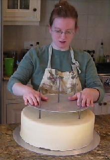 stacking a wedding cake image