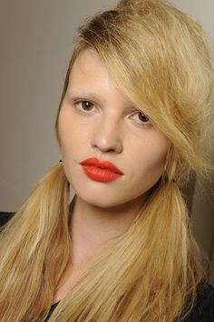 Spring/Summer 2010  Prada An almost bare-faced beauty look was pepped up with bold tomato lips at Prad