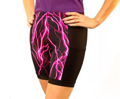Hotter than a prairie summer!  This new MuddBusters anti-ride short centers hot pink lightning within black wicking side panels which hold vented, slanted pockets.  The zipper pocket in the back holds your valuables safely and comfortably over the double-layer back panel (no see-through on this baby!) and an included drawstring.