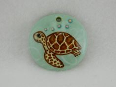Handmade colored porcelain sea turtle bead with white wavy lines 2 | Lundela - Jewelry on ArtFire  #handmade #jewelry #turtle #ocean