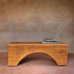 Solid Wood Bench Table - A dramatic curve is hand cut by craftsmen into a solid Pine wood beam to create this handsome bench. It is made-to-order in the USA from timber harvested in the mountains of New Mexico and usually ships within 6 weeks. Multiple sizes.