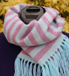 5e5538bbc949 Marshmallow is a scarf on a green background with stripes of white color  water pink and