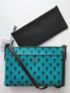 Coach F38159 Badlands Floral East West With Pop Up Pouch Turquoise ~ Black Cross Body Bag. Get the trendiest Cross Body Bag of the season! The Coach F38159 Badlands Floral East West With Pop Up Pouch Turquoise ~ Black Cross Body Bag is a top 10 member favorite on Tradesy. Save on yours before they are sold out!