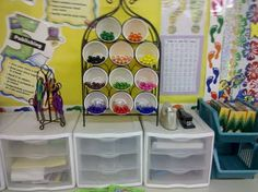 Wine rack with solo cups to hold markers.  Kids can grab the whole cup or just a few markers.