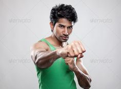 Giving a knockout punch ...  KO, active, activity, adult, aggression, asian, athlete, athletic, bicep, body, box, boxer, boxing, exercise, fight, fighter, fist, fit, fitness, guy, handsome, hard, health, healthy, hit, indian, knockout, macho, male, man, masculine, muscle, muscles, muscular, people, power, powerful, punch, sport, strength, strong, tough, training, work out, workout