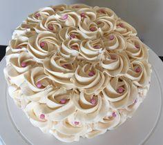Stunning ivory buttercream with pink pearls. Custom Creations Sudbury  customcreationsudbury@gmail.com  Find me on Facebook