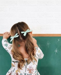 curled pigtails with bows