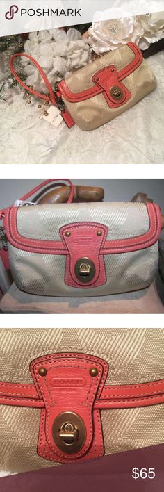 """Coach Legacy Signature Wallet Wristlet Style 42399 A larger Coach wristlet in a beautiful khaki color trimmed in coral leather. Turnlock Closure Flap Compartment on Front and Coach hangtag in coral color as well.  Size is approximately:  7"""" x 4.5"""" x 1.5""""  It does have a leather strap for easy carry and it has compartments for your items Coach Bags Clutches & Wristlets"""