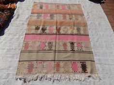 Check out this item in my Etsy shop https://www.etsy.com/listing/521819721/pastel-turkish-kilim-rugflat-weave