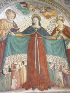 Femmes du village qui allaitent sous le manteau de la Vierge Artiste anonyme, 1514 Eglise de la Vierge de St. Nicolas, Vitorchiano (Viterbo), Italie